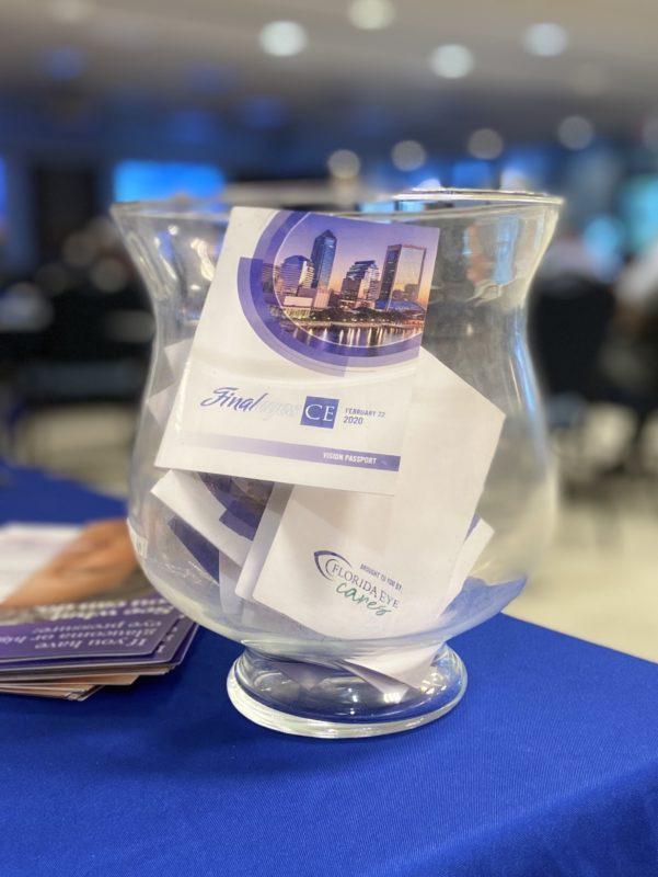 A glass jar containing business cards is sitting on a table