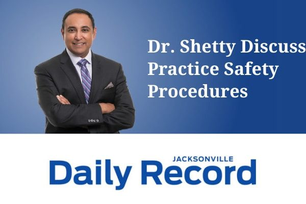 """Dr. Rajesh Shetty standing in front of a blue background with his arms crossed. The image reads """"Dr. Shetty Discusses Practice Safety Procedures"""" and includes the Jacksonville Daily Record logo."""