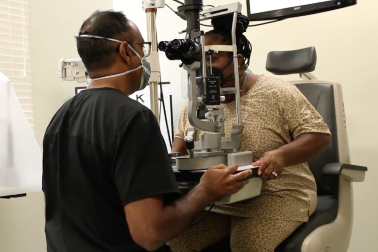 Dr. Shetty inspects Marian Rogers eyes during an eye exam