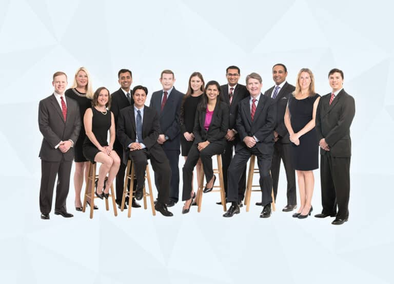 Florida Eye Specialists stand and smile as a group